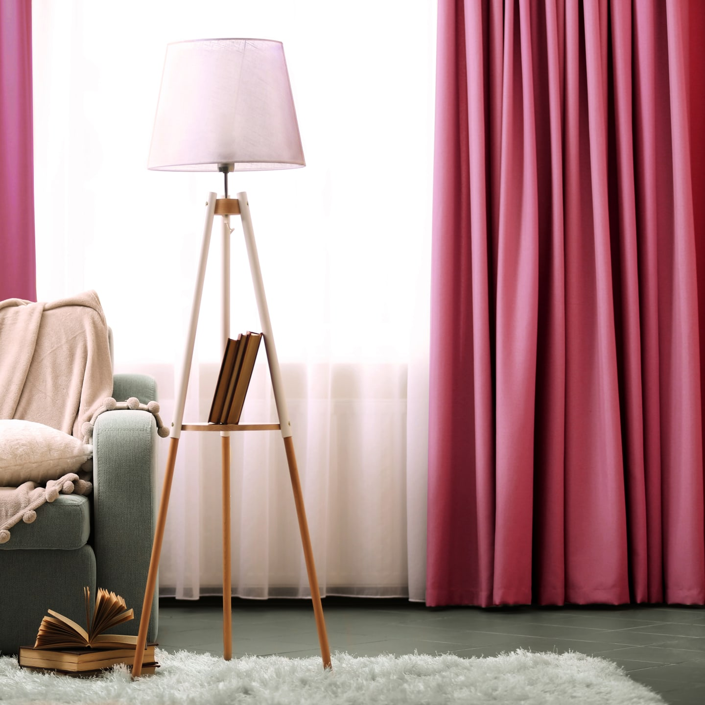 living room with pink curtains