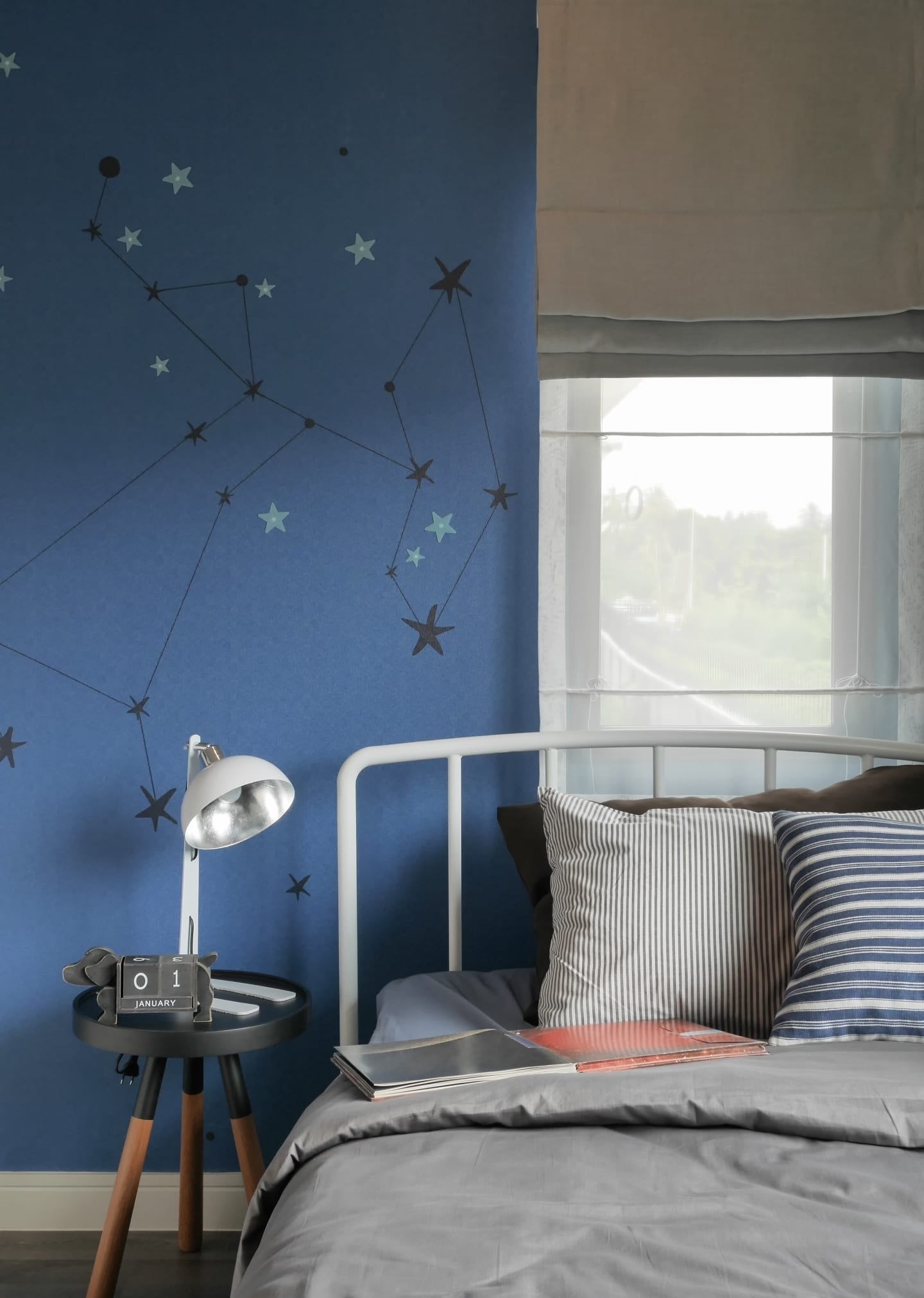 Star stickers on a blue bedroom wall