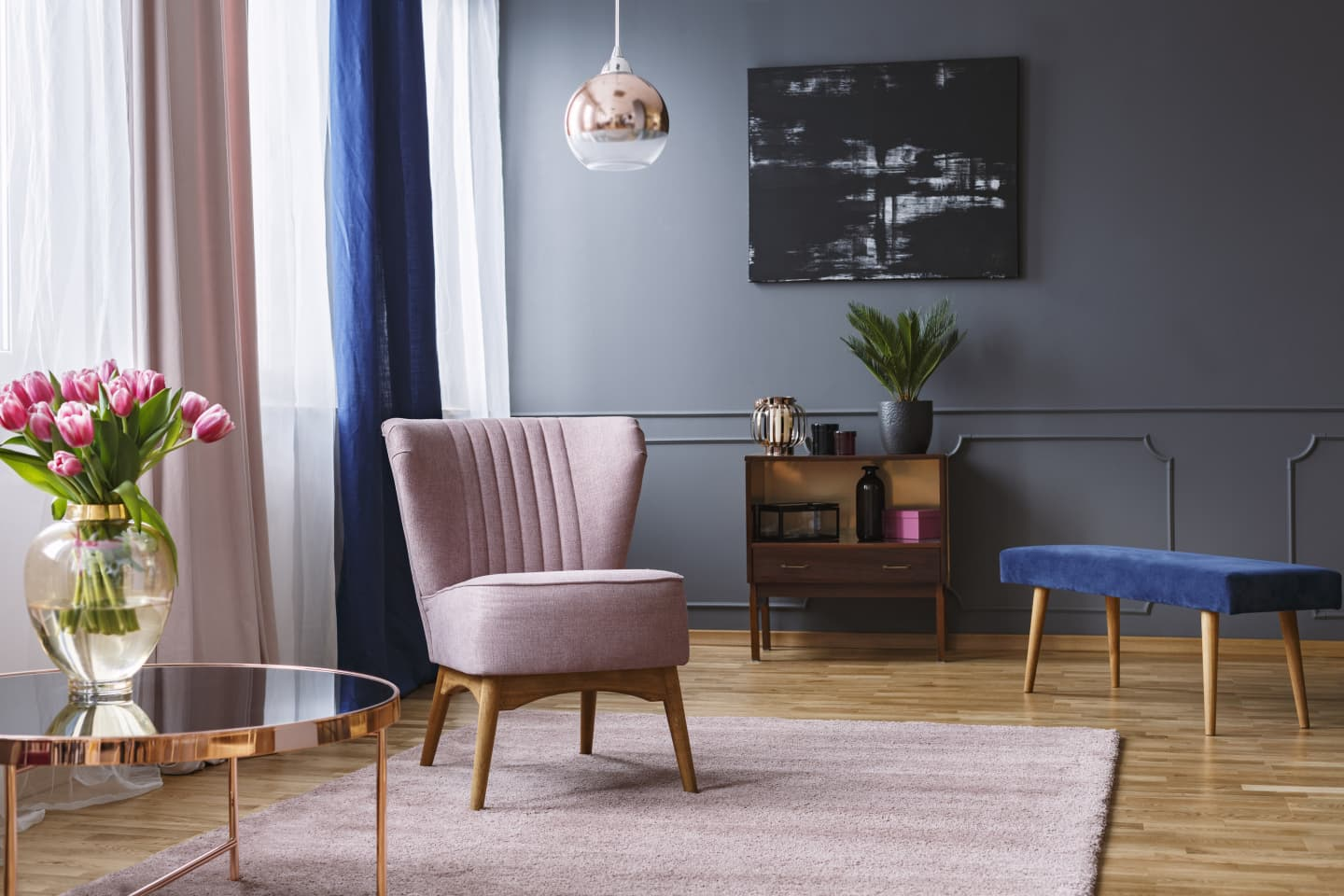 office-like sitting room with blue and grey curtains