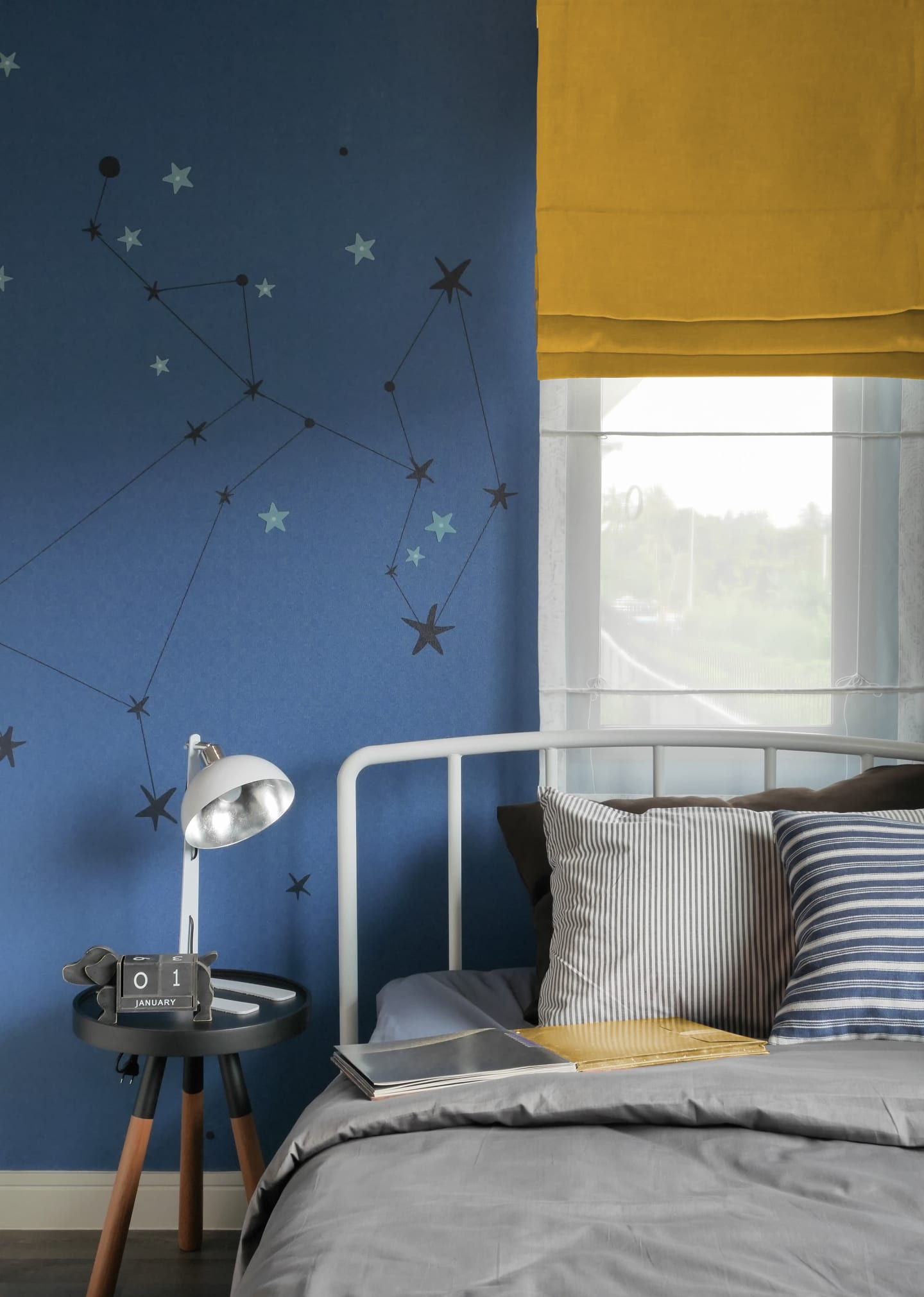 Stars on blue bedroom wall with yellow curtains