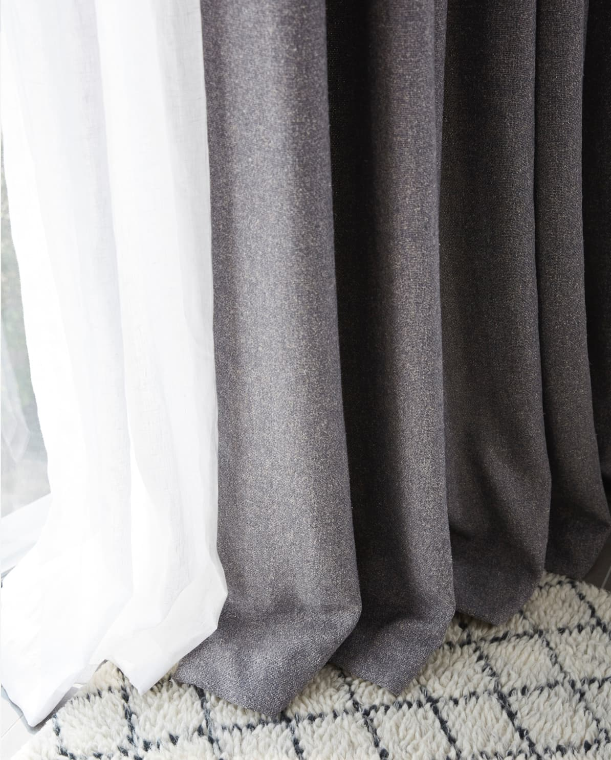 grey curtains touching the floor
