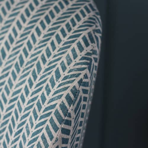 Close up of patterned fabric chair