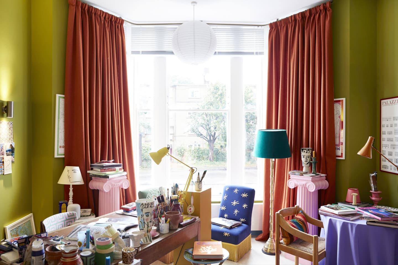 Orange curtains in artist study room