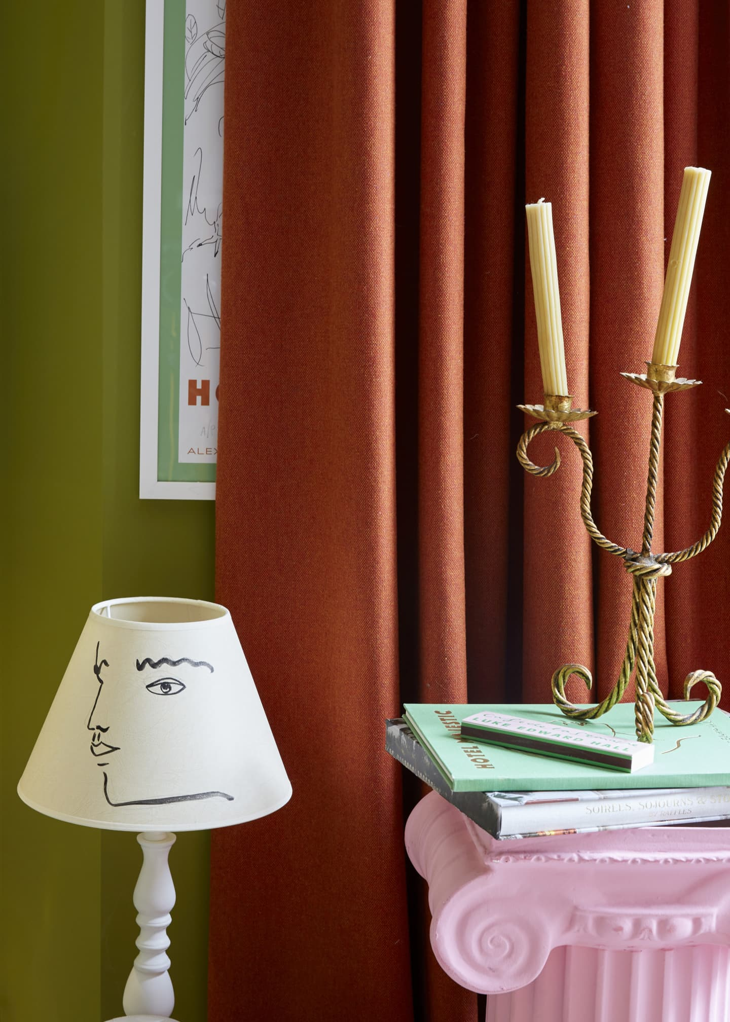 orange curtain behind pink pillar and lamp