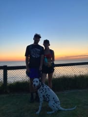 Dog lovers by the beach