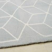 Alfombra con motivos decorativos grises y blancos 140x200 Kube