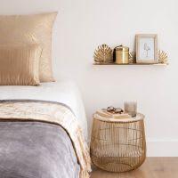 Bout de canapé en métal doré et blanc Bangai