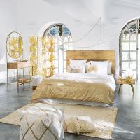 Kissen aus weißer Baumwolle mit goldfarbener Stickerei 45x45