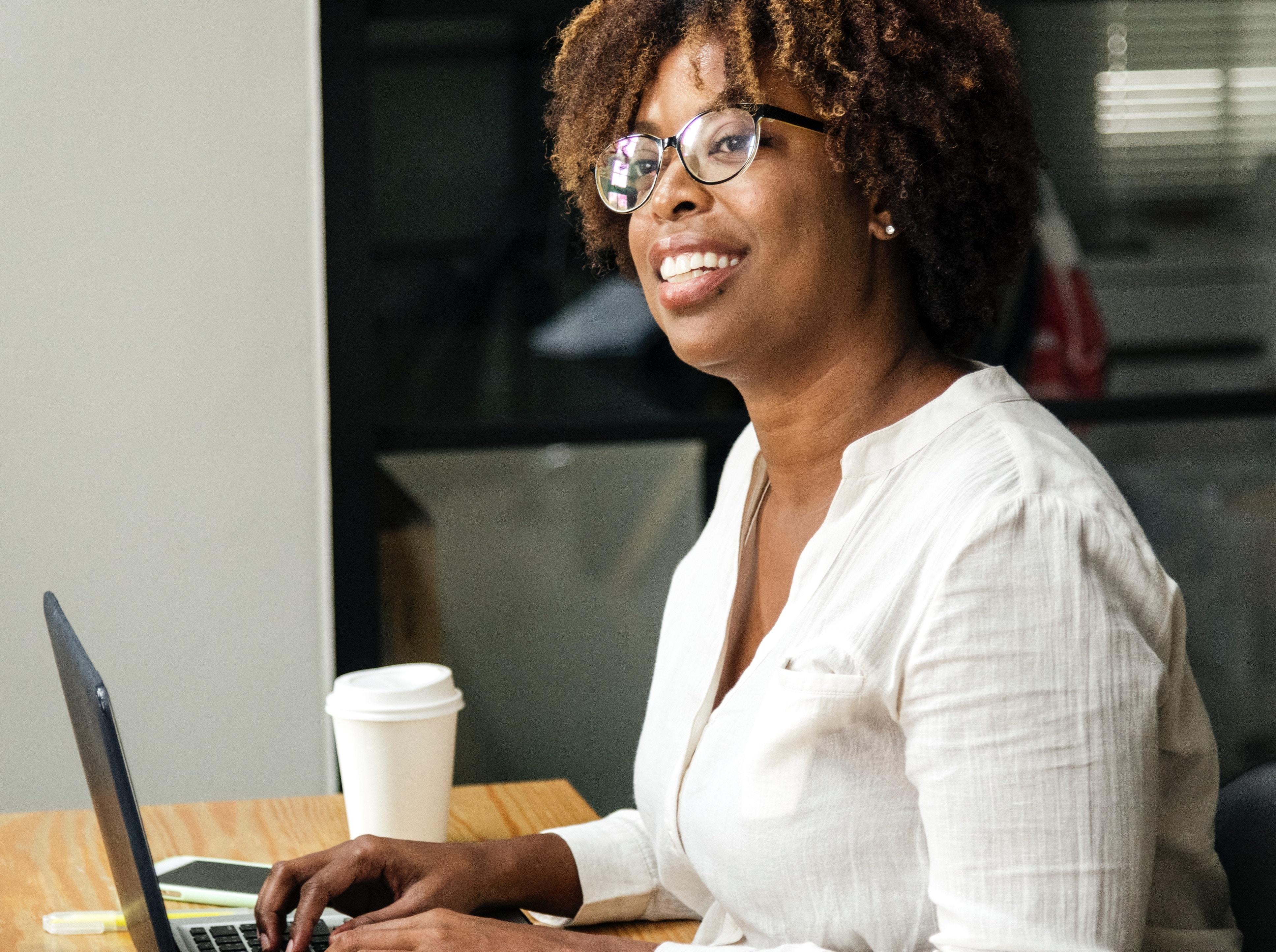 Women in Tech, woman programming on laptop - Photo by rawpixel on Unsplash