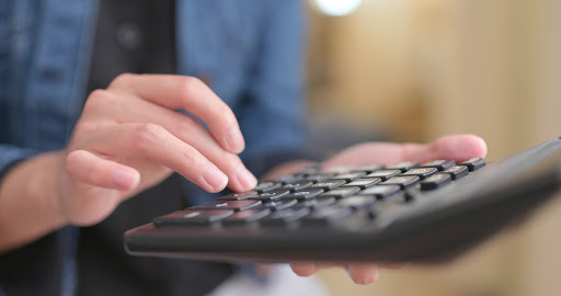 Person typing on a wireless keyboard