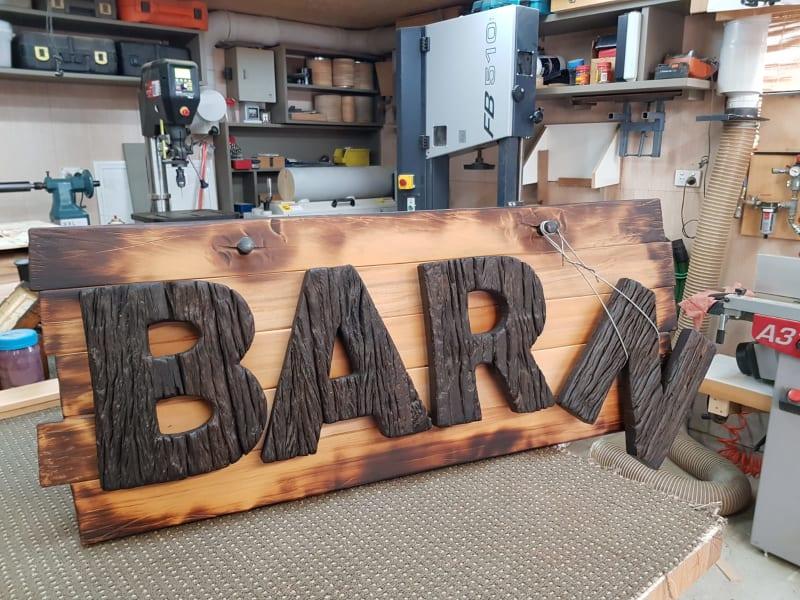 Handmade wooden sign by Daniel Strekier