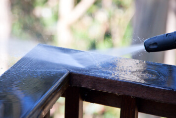 Image of a hand rail being pressured washed