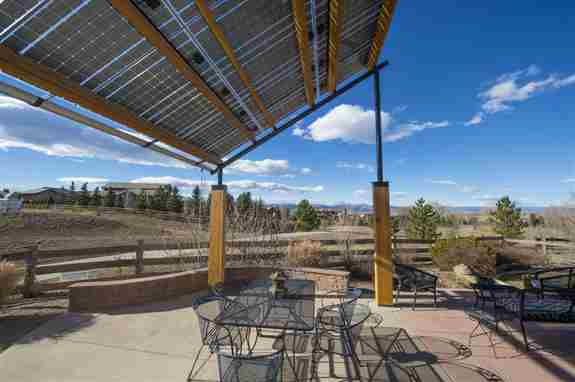 This is a solar pergola for a picnic area for employees.