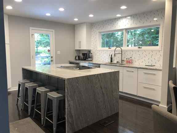 Kitchen with Large Island and granite waterfall.