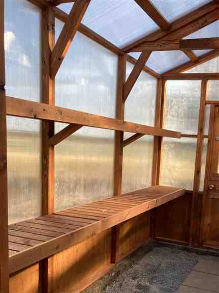 """8'x12' Premium Greenhouse interior. Showing the Included 18"""" Benches and 13"""" Shelves."""