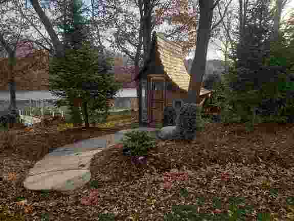Created a private lakeside yard with many hideaway spots for meditation and reflection. This chicken coop area is enjoyed for function and beauty as you enter with a whimsical theme.