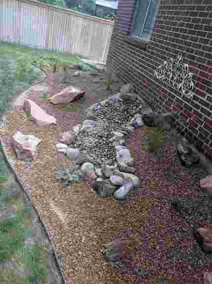 Dry river beds and larger rocks can add visual interest and create a variety of textures for year-round interest.