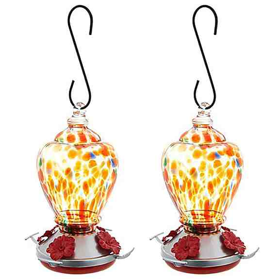 Ultimate Innovations Set of 2 Glass Hummingbird Feeders are designed to attract our feathered friends while adding beauty to your garden or yard.  Just fill with sweet nectar and hang!  Hummingbirds are attracted to the colors and the bright hibiscus flow