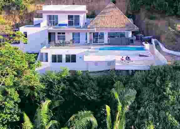 Custom build house in Njoi Santa Fe development (in the rainforest).