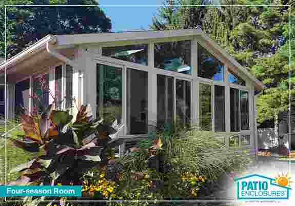 Enjoy the outdoors year-round in a Patio Enclosures four-season room.