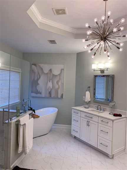 Custom bathroom remodel with sliding barn doors.