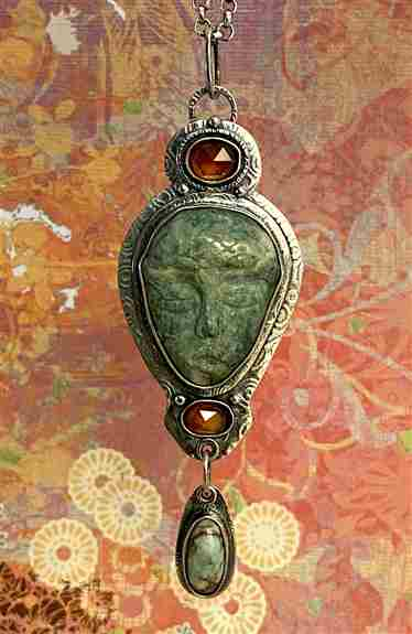 This piece is hessonite garnets, Variscite and Turquoise. I get a rather Ancient feeling about this necklace.