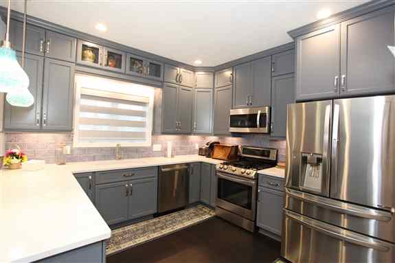 Blue cabinets with glass accent doors<br /><br />