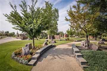 Our Prairie Walk garden offers a unique way of interring cremated remains and memorializing individuals including granite benches and private family columbarium.