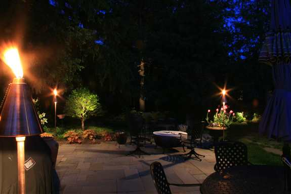 Faribault Residence Outdoor Patio with Low Voltage Light/Tiki Torches