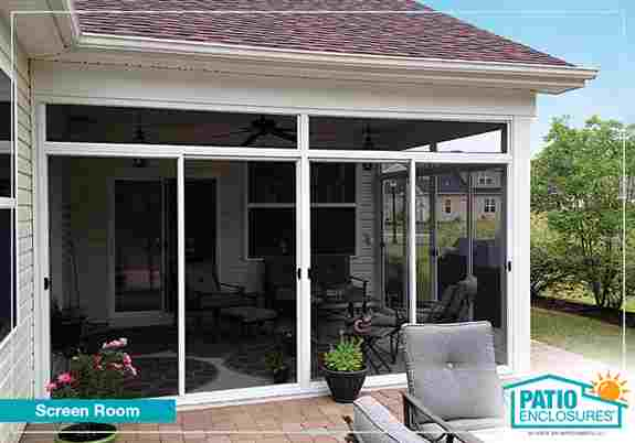 Enclose your patio with screens or glass to enjoy the outdoors protected from bugs and sun.