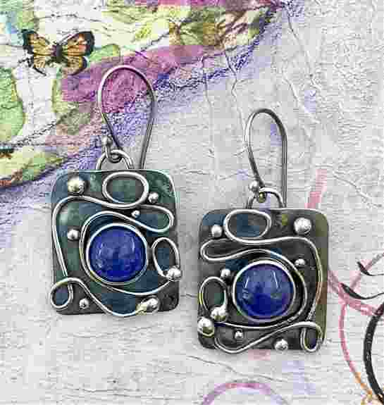 I'll have all kinds of fun earrings in every color of the rainbow to make those ears happy again. These are Tanzanite and Sterling Silver.