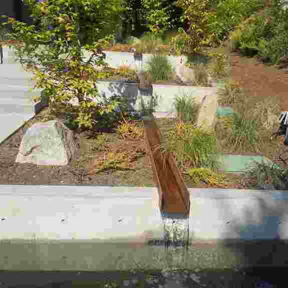 This project was reminiscent of our garden at last year's Flower and Garden Show with this awesome Corten steel runnel water feature.