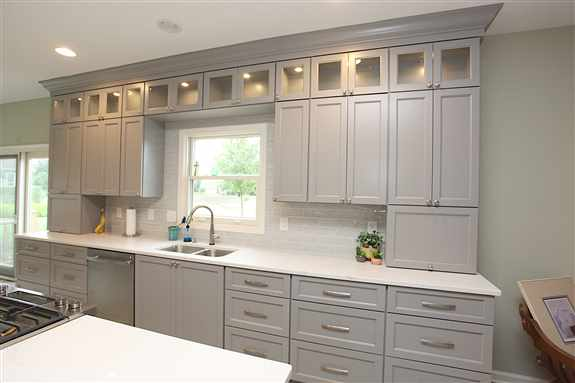 Kitchen with glass, doors & interior cabinet lighting <br />
