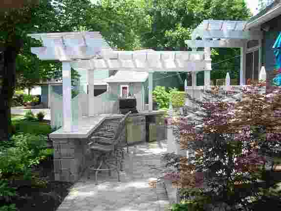 If you are planning on staycationing in your oun back yard this summer, you might consider having an outdoor kitchen as part of your plans!