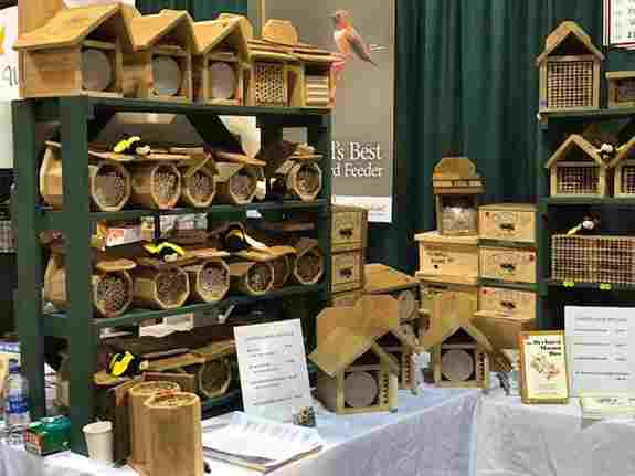 Variety of mason bee housing at our booth during previous shows