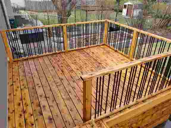 Cedar deck cleaned and ph neutralized only. This deck was solid weathered grey prior to our cleaning process.<br />No deck is too far gone.<br />Preparation is key to a successful stain adherence.