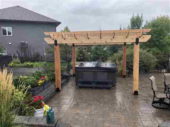 Custom cedar pergola structure to provide some summer shade on this beautiful Navaro paving stone patio