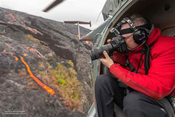 Photographing flowing lava from a doors-off chopper. Big Island of Hawaii, 2018.
