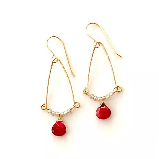 Ruby earrings on hand forged textured gold