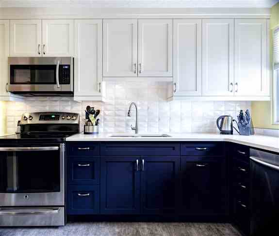 Fabulous two-toned blue and white cabinets!  The white countertop and white backsplash make the blue pop!