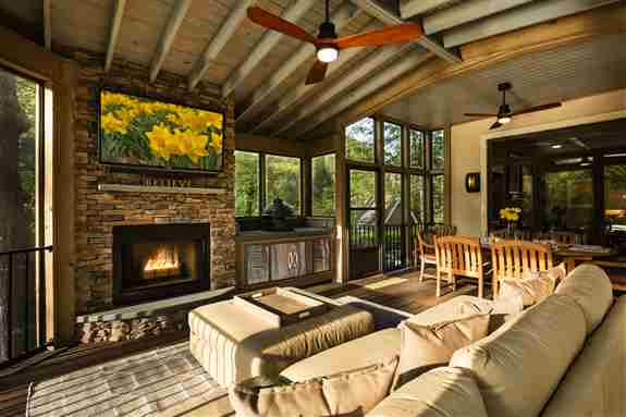 Outdoor screened porch with fireplace and green egg cooking station