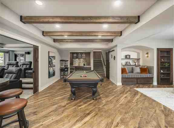 Basement Remodel with home theater, bookcase door, game room, wet bar, and custom ceiling details.
