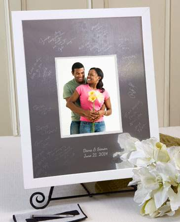 This Signature Keepsakes Mat comes complete with a wide modern white wood frame, one Signature Scribe, one cleaning cloth and one Guest Instruction card.  This flat white frame is a modern and simple accessory for any room.<br /><br />Signature Mats can h