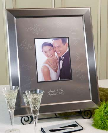 This Signature Keepsakes Titanium Frame comes complete with the silver-colored Titanium frame, one Signature Scribe, one cleaning cloth and one Guest Instruction card.  This silver-colored wide wood frame complements any modern, transitional or eclectic d