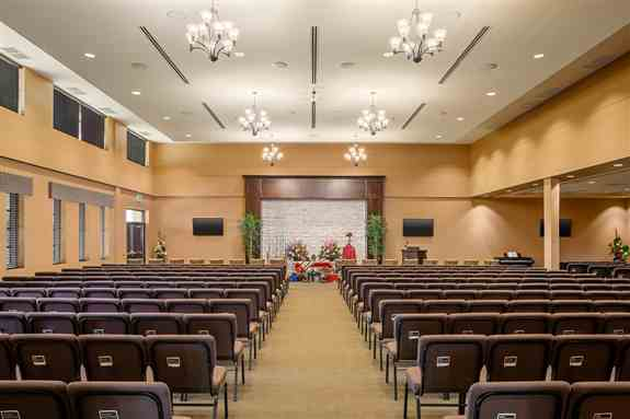 A photo of our main chapel in our new funeral home with seating for up to 350 guests.