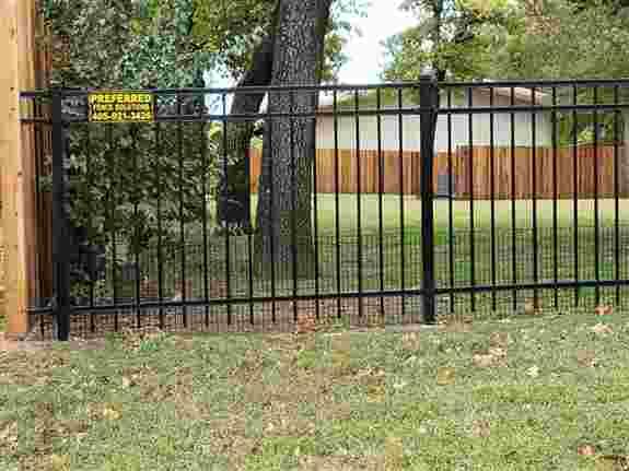 Stockade Fence + Ornamental Iron + Puppy Panel = One Happy Homeowner