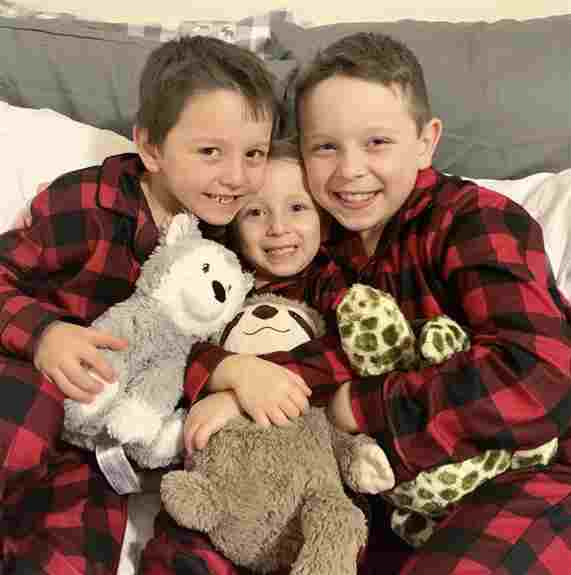 Three of our grandsons along with their respective Warmies. Jonah with the Husky, Jacoby with the Sea Turtle and of course, Jett with his Sloth. Our youngest grandson Jetty, in the middle, is who started our craze for the Warmies.