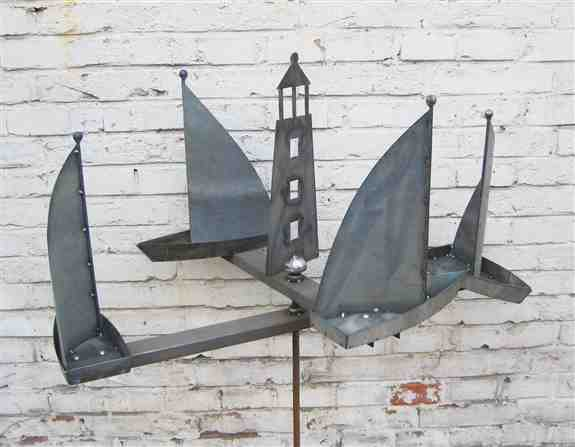 Sailboat wind spinner, sailboats go in opposite direction.