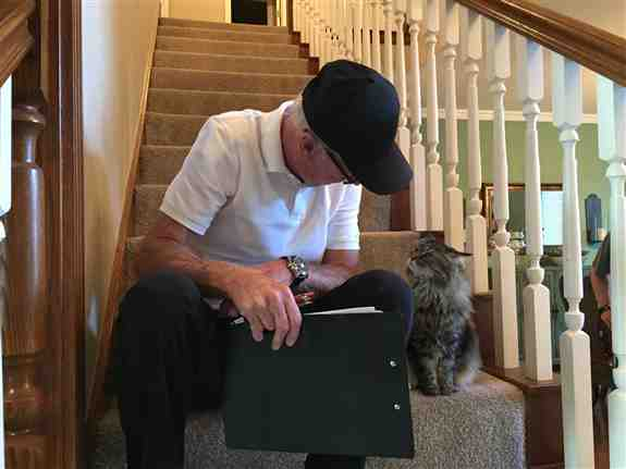 Our Sitter, Buddy, getting all the instructions from his feline client