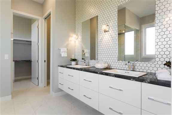 """Floating Ensuite featuring all drawers, (including """"perfectly fitted around the plumbing"""" sink drawers) for maximized space to fit all your needs."""